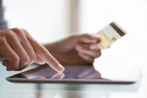 Woman,Shopping,Using,Tablet,Pc,And,Credit,Card,.indoor.close-up